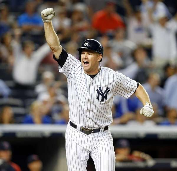 Chase Headley of the Yankees celebrates his walk-off