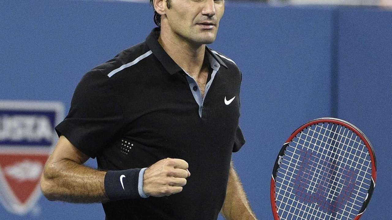 Roger Federer reacts against Gael Monfils at the