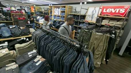 Shoppers browse the Levi's men's jeans department at