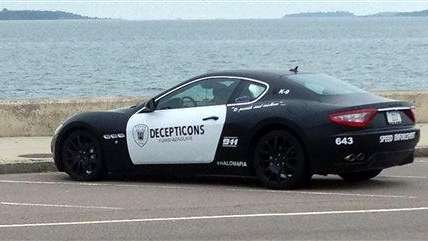 A Maserati resembling a police cruiser sits parked