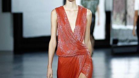 A model walks the runway at the Jason