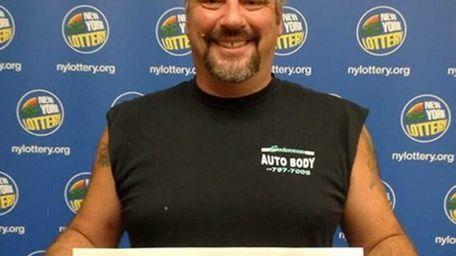 Lotto jackpot winner Jerry Ritieni, an auto body