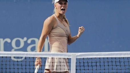 Caroline Wozniacki reacts after a shot against Peng