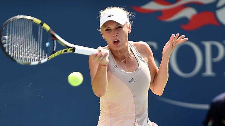 Caroline Wozniacki hits a forehand against Peng Shuai