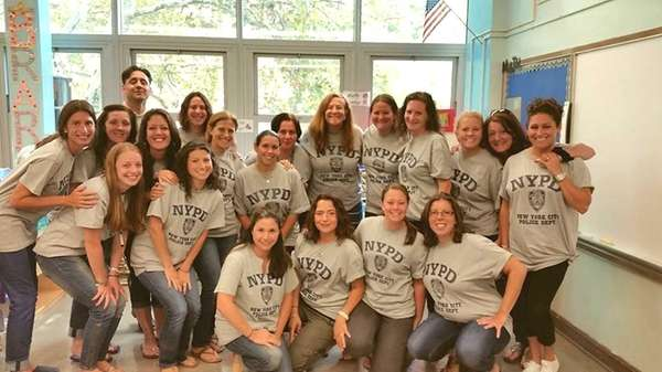 Teachers from P.S. 220 in Queens wear shirts