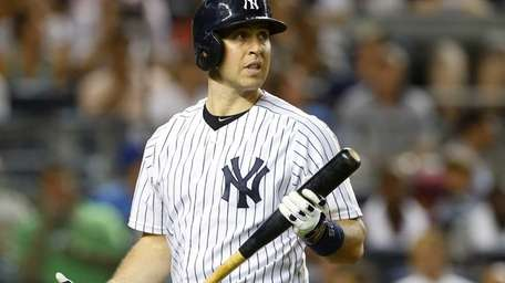 Mark Teixeira of the Yankees strikes out to
