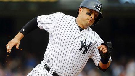 Martin Prado of the Yankees rounds third base