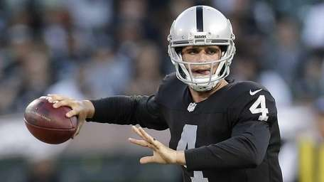 Oakland Raiders quarterback Derek Carr passes against the