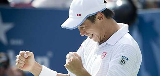 Kei Nishikori reacts after defeating Novak Djokovic in