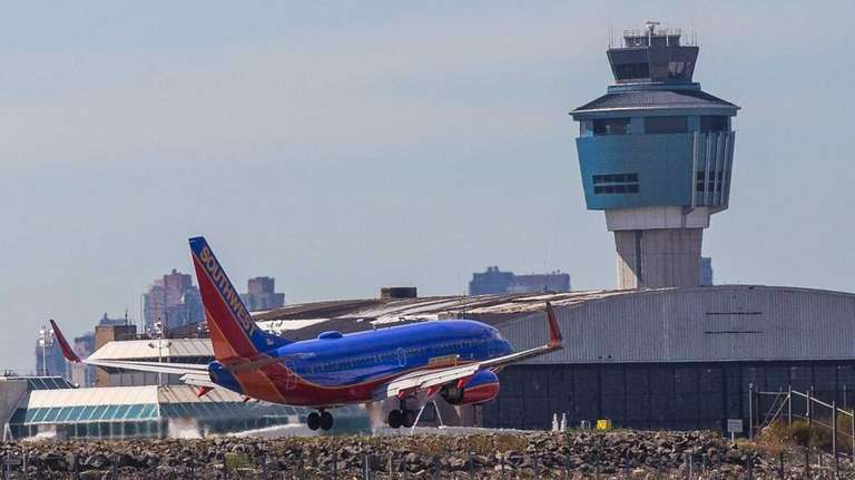 A commercial jet lands on runway 31 at