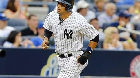 Martin Prado of the Yankees scores a fifth-inning