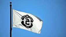 Flags with Derek Jeter's number on them fly