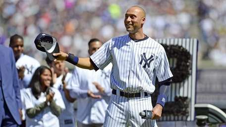 Yankees shortstop Derek Jeter waves to the crowd