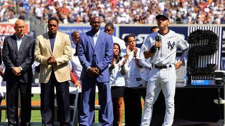 The Yankees' Derek Jeter speaks to the crowd