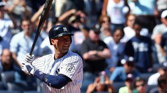 Derek Jeter bats in the first inning of