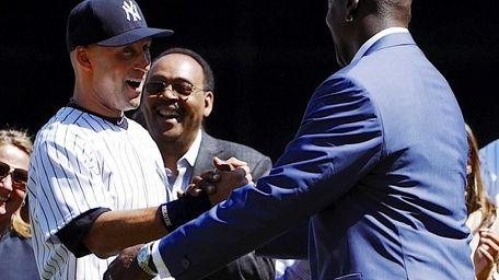 Yankees shortstop Derek Jeter greets Michael Jordan during
