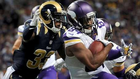 Minnesota Vikings wide receiver Cordarrelle Patterson, right, slips