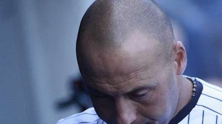 Yankees shortstop Derek Jeter leaves the dugout after