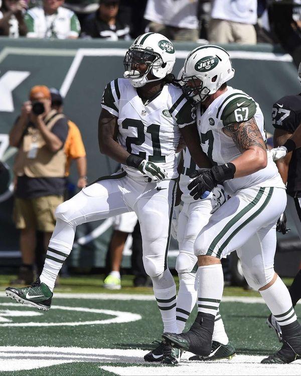 Jets running back Chris Johnson (21) celebrate his
