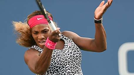 Serena Williams hits a forehand in the first