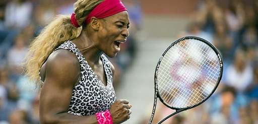 Serena Williams reacts after winning a point in