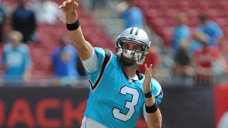Carolina Panthers quarterback Derek Anderson warms up before
