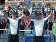 Bob, left, and Mike Bryan raise the men's