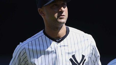 Yankees shortstop Derek Jeter looks on during a