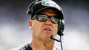 Jets head coach Rex Ryan looks on from