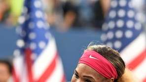 Serena Williams holds up the winning trophy after