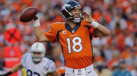 Denver Broncos quarterback Peyton Manning (18) throws against