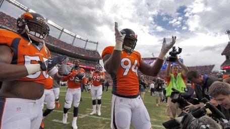 Denver Broncos defensive end DeMarcus Ware (94) motivates
