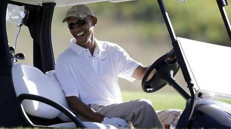 President Barack Obama at the wheel of a