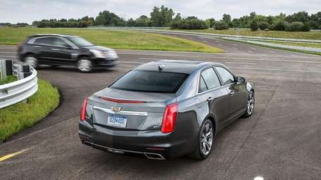 A 2015 Cadillac CTS, equipped with V2V technology,