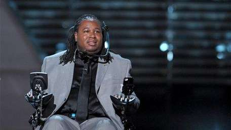 Eric LeGrand accepts the award for perseverance onstage