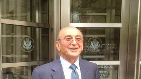 Chairman of Arab Bank, Sabih Taher al-Masri, outside