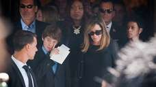 Melissa Rivers, right, and her son Cooper, following