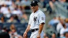Yankees manager Joe Girardi walks off the mound