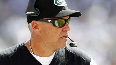 Jets head coach Rex Ryan looks on against
