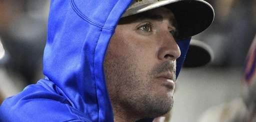 \Mets pitcher Matt Harvey looks on from the