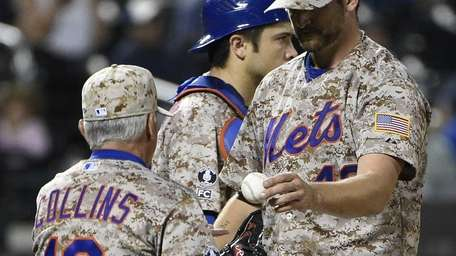 Mets manager Terry Collins takes the ball from