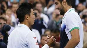 Kei Nishikori, of Japan, left, greets Marin Cilic,