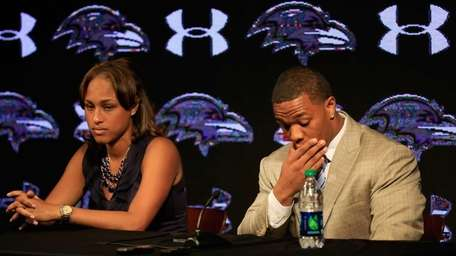 Ray Rice pauses while addressing reporters with his