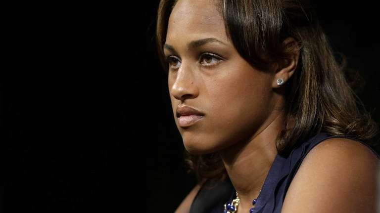 Janay Rice listens as her husband, now former