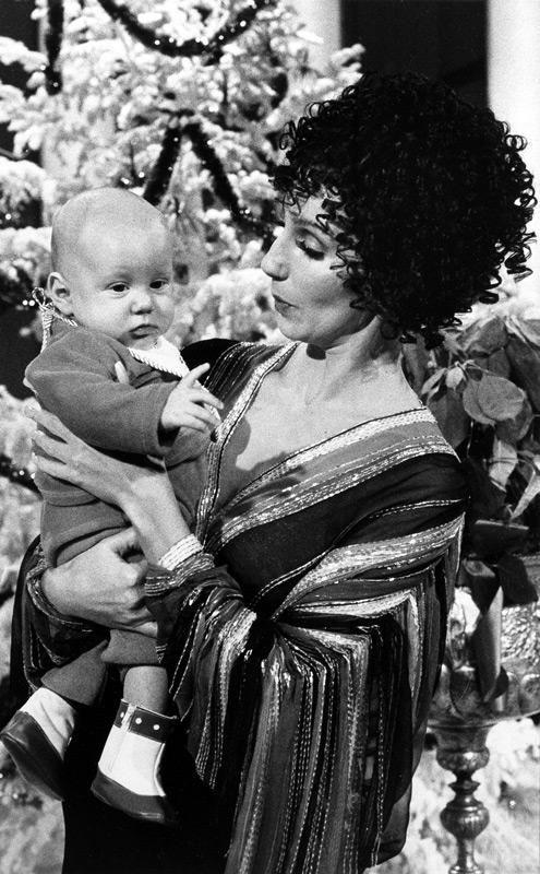 Cher holds her 4-month-old son, Elijah Blue Allman,