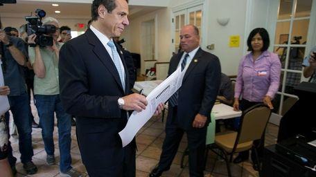 Gov. Andrew M. Cuomo walks to record his