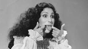 Entertainer Cher sticks her tongue out during taping