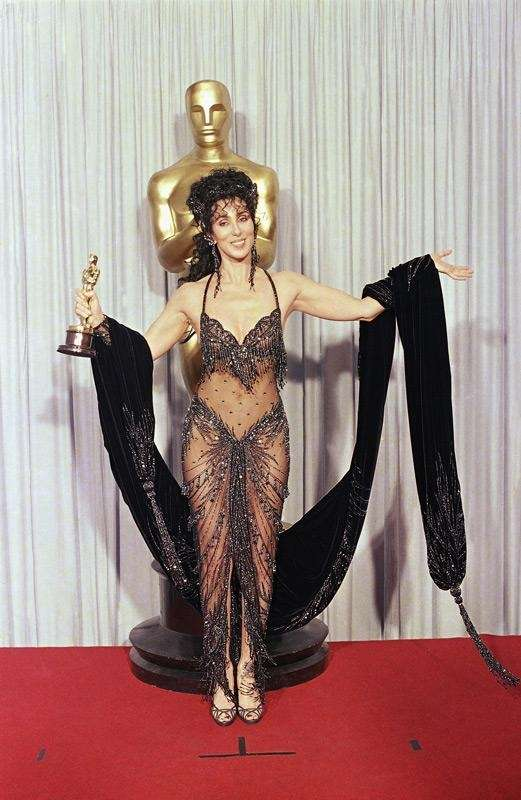 Cher shows off her Oscar and Bob Mackie
