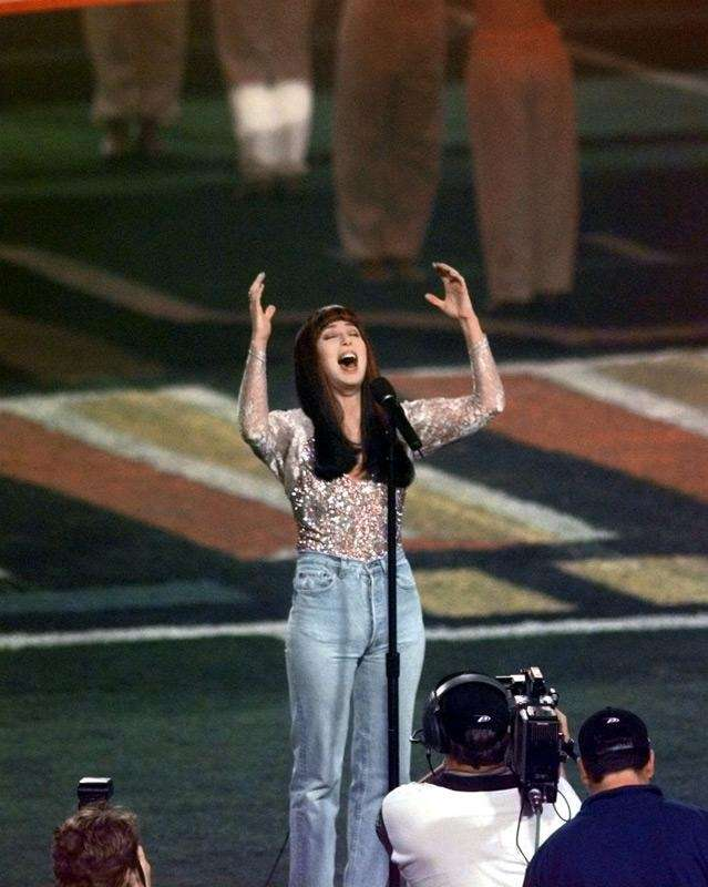 Cher performs the National Anthem before the start