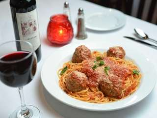 A respectable spaghetti with meatballs is served at